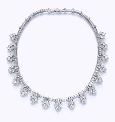 A DIAMOND NECKLACE, BY VAN CLEEF & ARPELS   The baguette-cut diamond band, spaced by bullet-cut diamonds, suspending a series of circular-cut diamond trefoils, mounted in platinum, 14½ ins.  Signed Van Cleef & Arpels, N.Y., no. 15803