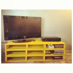 Different color, only two long ones, with roller feet. DIY Pallet TV stand, might try this in my room
