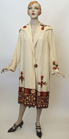 FC0391 Coat, silk, silk embroidery with shisha (mirror work), unlabelled, made in India (probably around Gujerat) and commonly resold in Egypt for the tourist trade, c. mid-late 1920s