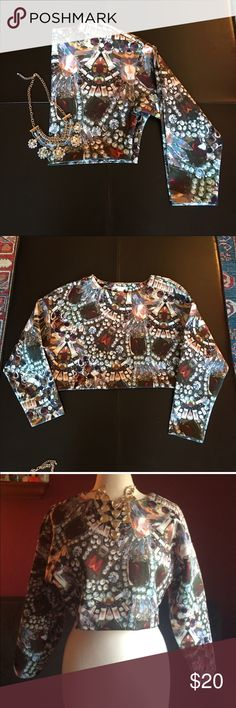 """H&M Jewel Print Scuba Crop Top Scuba material crop top has long sleeves and a scoop neck. Measures 16"""" inches long, 20"""" inches armpit to armpit with 17"""" inch long sleeves. Looks great over a white or black blouse/shirt. Polyester/Elastine blend. Machine Wash. H&M Tops Crop Tops"""