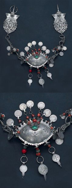 Morocco | Pectoral ornament; Silver, glass cabochon and silver, coral and coin pendants | Rif region, Nador and Melilla region | Late 19th century  | Est. 2 000 - 3 000€ (Feb '13)