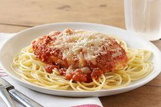 No need to bread and fry cutlets to make this chicken Parmesan. Baking the chicken in spaghetti sauce infuses it with flavor and cuts down on prep.