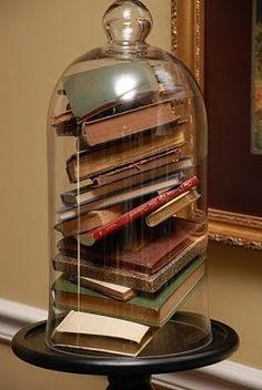 Tall cloche filled with small books. Love. It.   The Cottage Market: 25 ways to decorate with books...free bookplate printable and thankful Thursday winner
