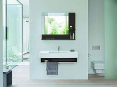 The Duravit New Vero console and mirror provides countertop display space, a range of open shelving and a useful towel rail Price on application from Duravit