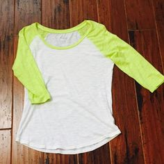 Neon baseball t-shirt This is a very cute white and like a neon yellow/green color t shirt.  The white is pretty sheer so a cami under is necessary.  3/4 sleeves.  There are a couple of pulls on one of the sleeves but they aren't that noticeable. Express Tops Tees - Long Sleeve