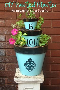 Anatomy of a Craft: Painted Planter/HAVE THESE COLORS,STENCILS, PUT WHITE SHELLS ON TOP BORDER. damask stencil black , mix blue paint, make this design on bedside tray,pencil cups, will match quilt cover,do all my plant pots today