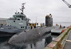 HMCS Chicoutimi was under tow to Ogden Point April 16 to conduct acamber dive.Key moment in submarine's Extended Docking Work Period that began in 2010.Camber dive early stepping stone in Chicoutimi's return to fleet,expected later this year,as advances through extensive test & trial program.Camber dive verifies submarine's watertight integrity,& functionality of comms & other key systems.Dives occur in protected harbours where water is deep enough for the submarine to be fully submerged.