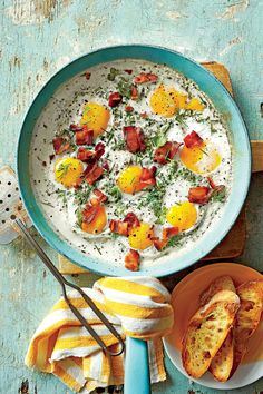 Creamy Baked Eggs with Herbs and Bacon | Serve with toasted bread and a leafy green side salad.