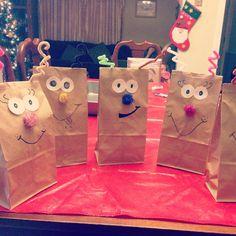 Reindeer goodie bags. Using brown paper bags, pom poms & pipe cleaners. -- took 15 minutes (: