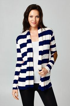 The perfect fall cardigan. Color blocked print and elbow patches. Available in navy or black.