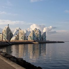 The Iceberg, Aarhus, Denmark.   JDS Architects, the creators of the harbor-front apartment complex, is the recipient of multiple architectural honors for its functional and smart design: The jagged lines maximize the amount of sunlight, while the interspersed placement provides a view of the ocean from each building.
