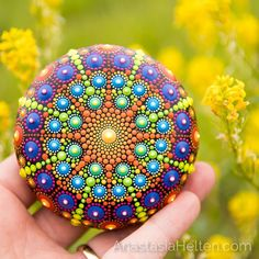 Bright and colorful  I love creating mandalas and like so much to take photos of the beauties surrounding us   #mandala #mandalastones #mandalasworld #mandalaart