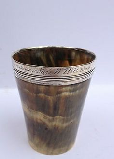 Early horn drinking cup with silver mount.  google.com