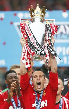 ~ Robin van Persie of Manchester United holding his first ever Barclays Premier League Trophy ~