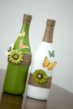 This is ONE bottle, displayed here as a set. It is painted antique white with added twine, flowers and butterflies. You can choose which to pair (Bottle Crafts) Wine Bottle Corks, Glass Bottle Crafts, Diy Bottle, Glass Bottles, Bottle Vase, Reuse Bottles, Juice Bottles, Water Bottles, Wine Craft