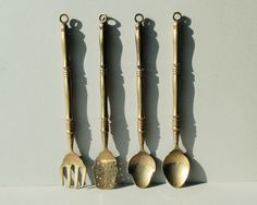 Four big brass vintage kitchen utensils