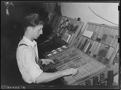 Setting type by hand. Newspaper office. San Augustine, Texas