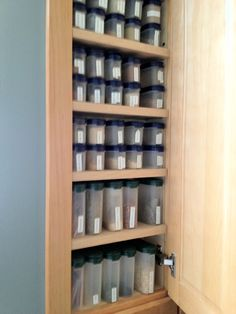Tupperware spice containers sit perfectly in my custom cabinet, nestled between wall studs. Spice Storage, Spice Organization, Kitchen Pantry, Kitchen Cabinets, Kitchen Ideas, Tupperware Organizing, Spice Containers, Custom Cabinets, Bathroom Medicine Cabinet