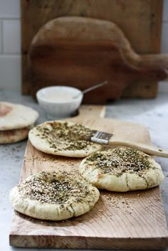 Homemade pita bread, brushed with olive oil and Zaatar- a Middle Eastern spice mix. A flavorful snack on its own - or serve with tahini sauce and  baba ganoush for a delicious appetizer. Vegan!