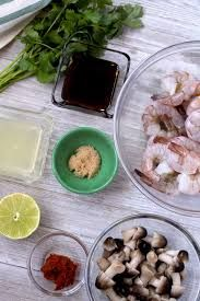 View of ingredients for Thai Tom Yum Soup on a white wooden board. Fresh raw shrimp with the tails on. Lime juice, fish sauce, brown sugar, Thai red chili paste, straw mushrooms and fresh cilantro. Thai Chicken Recipes, Thai Basil Chicken, Asian Recipes, Soup Recipes, Hot And Sour Soup, Hot Soup, Spicy Thai Soup, Tom Kha Soup, Coconut Curry Soup