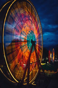 This ferris wheel has slow shutter speed even though it looks like the ferris wheel is going fast. There is usually spaces in the ferris wheel but because of the shutter speed there is none.