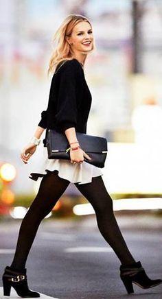 Jim Rohn. white flared skirt, black tights, clutch #fall #style #winter