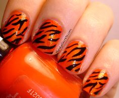 Tiger stripe nail art perfect for tournament time neat tiger striped nails prinsesfo Image collections