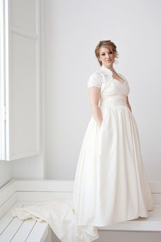 Love this dress, esp the bodice. It would be cute cut short, too ...Offbeat Bride