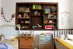 I love how she's displayed her quirky collection of beautiful finds in her kids room.