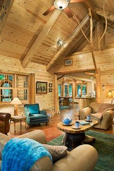 Great room with log rafters and twig accents