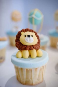 See more party ideas and share yours at CatchMyParty.com #catchmyparty #partyideas #4favoritepartiesoftheweek #hotairballoonparty #animallparty #lioncupcakes
