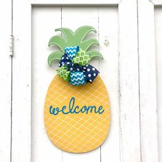 Our pineapple welcome sign will offer hospitality to your guests before the even come inside! The pineapple has always been a sign of welcome and this one is stepped up a notch. The classic yellow and green design offers a look you will love through the spring and summer.  The wooden pineapple is