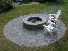 brick firepit surrounded by gravel.