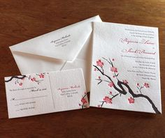 Japanese cherry blossoms adorn calligraphy-styled branches, perfect for those casual, yet elegant celebrations.