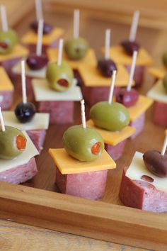 Antipasto Skewers _ make it easy for your guests to enjoy the treats & conversation! I used a hard summer sausage, cheese slices, & I topped it with green or kalamata olives. Take creative liberties with this one. Try different meat & cheese combos.