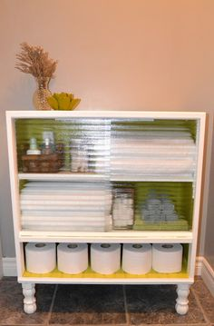 Dresser repurposed to storage for the bathroom