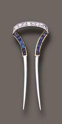 ART DECO SAPPHIRE AND DIAMOND HAT PIN BY CARTIER: Designed as a calibré-cut sapphire, old European and single-cut diamond hat pin, mounted in platinum and gold, circa 1920. Signed Cartier Paris New York.
