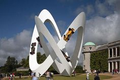 These Car Sculptures Look Impossible!/ 2012- Lotus...the sculpture, displays six Lotus Formula One cars donated by Lotus Cars-Lotus 32B (Jim Clark 1965), Lotus 49B (Graham Hill 1969), Lotus 72E (Emerson Fittipaldi 1973), Lotus 79 (Mario Andretti 1978), Lotus 99T (Ayrton Senna 1987) and the latest Lotus F1 Team Challenger...the road they drive on....