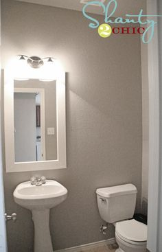 Guest bathroom makeover with Dutch Boy Route 66 and DIY mirror frame. -- Maybe use this paint color in the Small bath Room Colors, Wall Colors, House Colors, Bathroom Renos, Small Bathroom, Design Bathroom, Bathroom Ideas, Light Gray Paint, Farmhouse Paint Colors