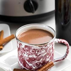 The hit of the holiday party: Chocolatey, warm cocoa mulled with red wine and McCormick® Cinnamon and Nutmeg. Prepared in your slow cooker so you...
