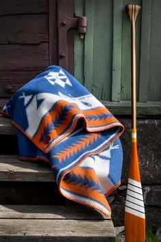 """Blanket """"The art of canoeing"""" design by Bucks and Spurs, handmade paddle by Sanborn Canoe"""