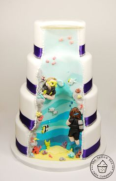 Everything's better where it is wetter! Adorable SCUBA surprise wedding cake.  By The Yellow Bee Cake Company