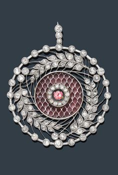 A BELLE EPOQUE PLATINUM, ENAMEL AND DIAMOND PENDANT, CIRCA 1910. The round floral openwork decorated at the centre with pink plique-à-jour enamel and a polychrome rose motif, set with 35 old European-cut diamonds, smaller old European-cut and single-cut diamonds and a rose-cut diamond.