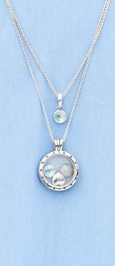 Carry your birthstone in our PANDORA floating locket and capture the look of the season.