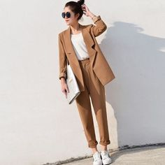 I think that, like me, you must love chic and comfortable looks. One way to obtain this is by combining pant suits with sneakers. These kinds of outfits can be considered unusual, but they're stylish.