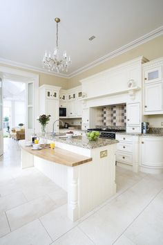 cream hand painted kitchen fits perfectly in this period home