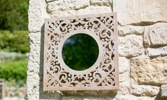 Enhance your garden with this ornate mirror. This mirror is made of metal for use both indoors and outdoors. A large 60x60cm, this mirror will help make smaller gardens look bigger and decorate any garden or conservatory.
