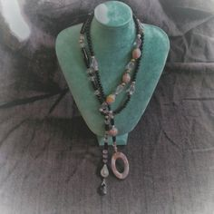 Check out this item in my Etsy shop https://www.etsy.com/listing/289431159/gorgeous-multi-wear-style-necklace