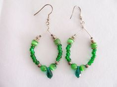 Emerald green hoop earrings with cat's eye quartz and Swarovski crystal teardrops by SparkleandComfort, $6.99