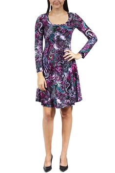 For a splash of bold flair on a classic cut for any event throughout the year, look no further than this stunning long sleeve sheath dress from 24/7 Comfort Apparel. With a scoop neckline and knee-length hem, this simple dress is brought to life with a vibrant paisley print, sure to turn heads day and night.   Paisley Sheath Dress by 24/7 Comfort Apparel. Clothing - Dresses - Printed Clothing - Dresses - Long Sleeve California